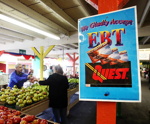 A sign announcing the acceptance of electronic Benefit Transfer cards is seen at a farmers market in Roseville, Calif.   Currently food stamp recipients have had problems purchasing food at farmer's markets  because many of them do not accept the EBT cards that food stamp recipients use to buy groceries.  A bill currently in the legislature would change that by helping farmers markets overcome bureaucratic hurdles to obtain the equipment needed to read the benefit cards