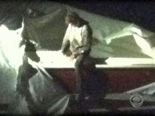 This image obtained Friday courtesy of CBS News shows Dzhokhar Tsarnaev, a suspect in the Boston Marathon bombing, exiting the boat where he was captured in Watertown, Mass.(Photo: CBS News via AFP/Getty Images)