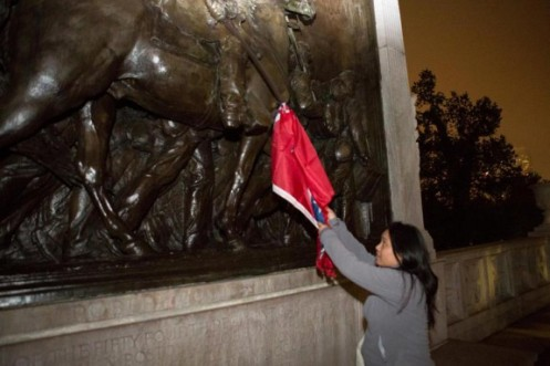 Melissa Carino pulled down a Confederate flag from the Robert Gould Shaw and Massachusetts 54th Regiment Memorial across from the State House on Sunday. Read more: http://www.thegatewaypundit.com/2015/06/fake-hate-black-activist-admits-hanging-confederate-flag-from-soldier-memorial.